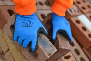 A Halton Construction builder working with the Showa 306 glove