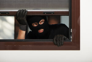 thief burglar at house breaking